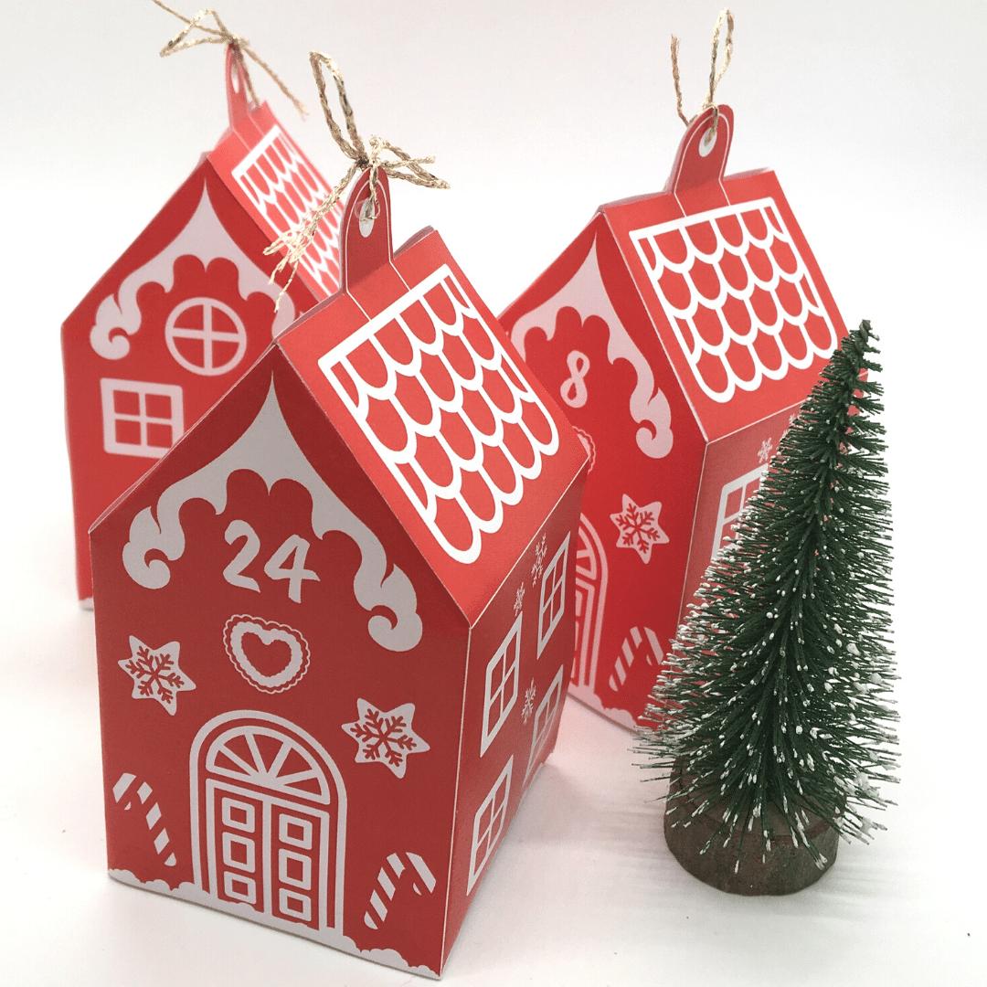 En julekalender med 24 røde huse - Lou Noire - pakkekalender